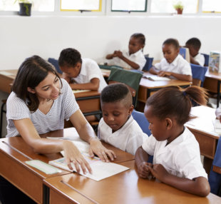 woman teaching children in school