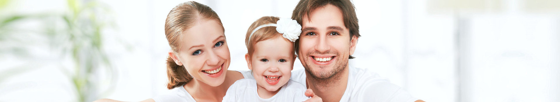couple with thier child smiling