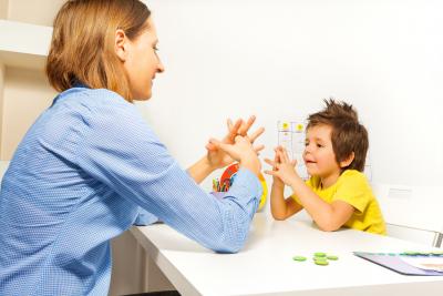 female expert mentoring child