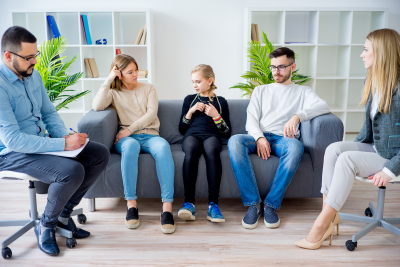experts counseling couple with their child