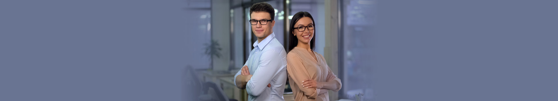 Male and female office workers looking in camera